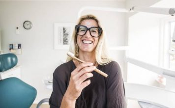 Dentist Nicky Francis of Do Gooder with an eco friendly toothbrush.