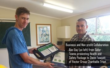 Ben Day (on left) from Safer Teams presenting Health and Safety Package to Steve Fawcett of Vector Group Charitable Trust.